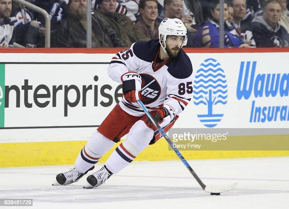 Mathieu Perreault of the Winnipeg Jets plays the puck down the ice during third period action against the Calgary Flames at the MTS Centre on January...