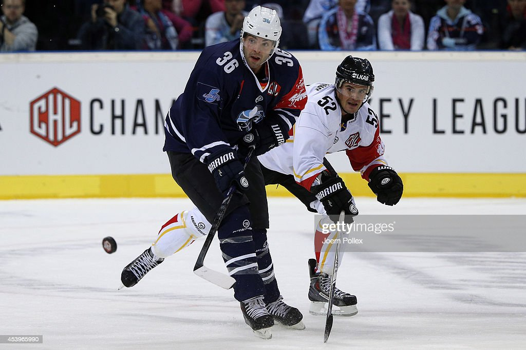 Mathieu Roy (L) of Hamburg and Karl Fabricius of Lulea compete for the puck during the Champions Hockey League group stage game between Hamburg Freezers and Lulea Hockey on August 22, 2014 in Hamburg, Germany.