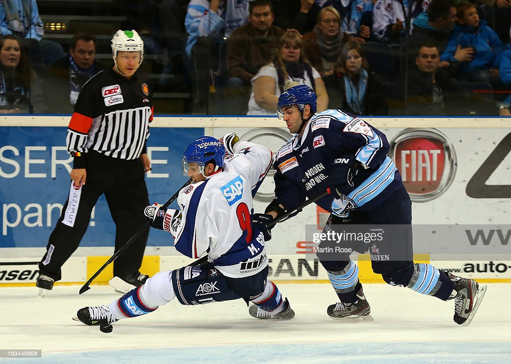 Mathieu Roy (R) of Hamburg battles for the puck with <a gi-track='captionPersonalityLinkClicked' href=/galleries/search?phrase=Marcel+Goc&family=editorial&specificpeople=541626 ng-click='$event.stopPropagation()'>Marcel Goc</a> (L) of Mannheim during the DEL match between Hamburg Freezers and Adler Mannheim at O2 World on October 5, 2012 in Hamburg, Germany.