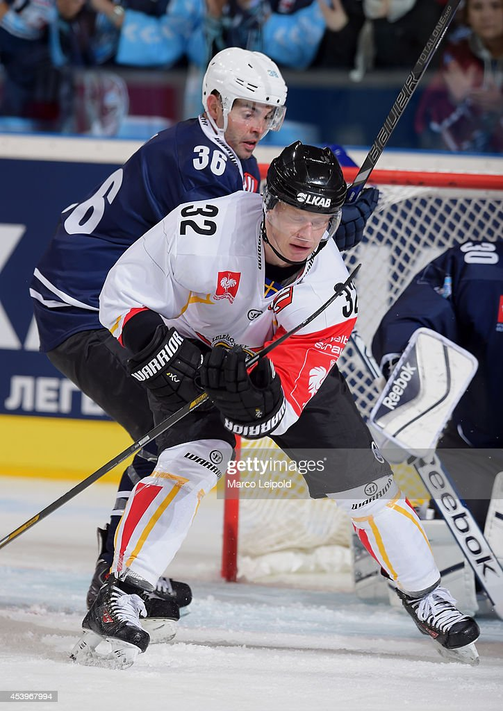 Mathieu Roy #36 of Hamburg Freezers and Lennart Petrell #32 of Lulea Hockey struggle for a better position in front of the net during the Champions Hockey League group stage game between Hamburg Freezers and Lulea HF on August 22, 2014 in Hamburg, Germany.