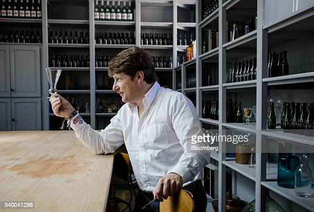 Mathieu Sabbagh international director of communications at Pernod Ricard SA poses for a photograph as he holds a pontarlier reservoir glass in the...