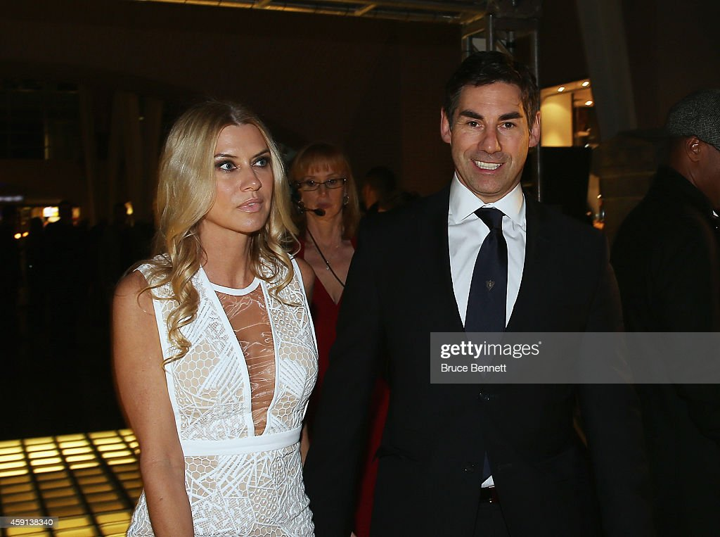 Mathieu Schneider and his wife Shannon walk the red carpet prior to the induction ceremony at the Hockey Hall of Fame on November 17 2014 in Toronto...