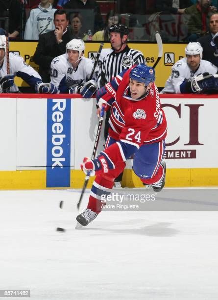 Mathieu Schneider of the Montreal Canadiens fires a slapshot against the Tampa Bay Lightning at the Bell Centre on March 26 2009 in Montreal Quebec...