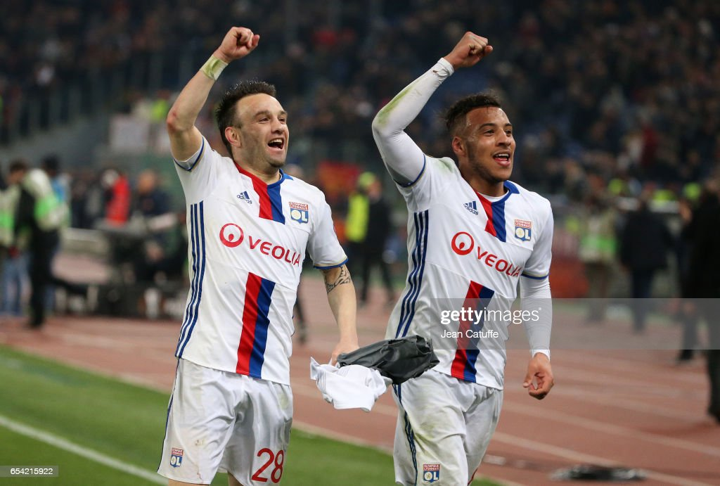 Mathieu Valbuena and Corentin Tolisso of Lyon celebrate the qualification following the UEFA Europa League Round of 16 second leg match between AS Roma and Olympique Lyonnais (OL) at Stadio Olimpico on March 16, 2017 in Rome, Italy.