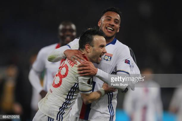 Mathieu Valbuena and Corentin Tolisso of Olympique Lyonnais celebrates after the UEFA Europa League Round of 16 second leg match between AS Roma and...