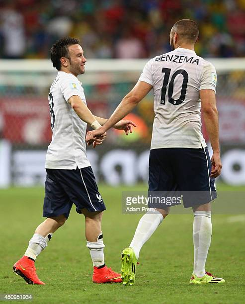 Mathieu Valbuena and Karim Benzema of France react during the 2014 FIFA World Cup Brazil Group E match between Switzerland and France at Arena Fonte...