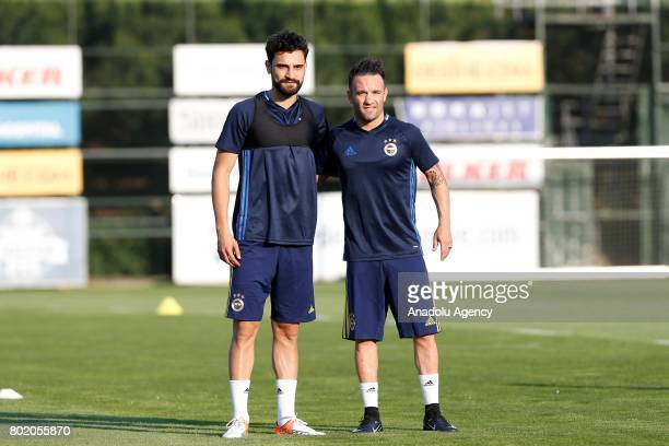 Mathieu Valbuena and Mehmet Ekici of Fenerbahce pose during the club's training session ahead the Turkish Super Toto Super Lig new season on June 27...