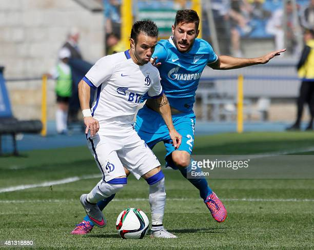 Mathieu Valbuena of FC Dinamo Moscow and Javi Garcia of FC Zenit St Petersburg vie for the ball during the Russian Football League match between FC...