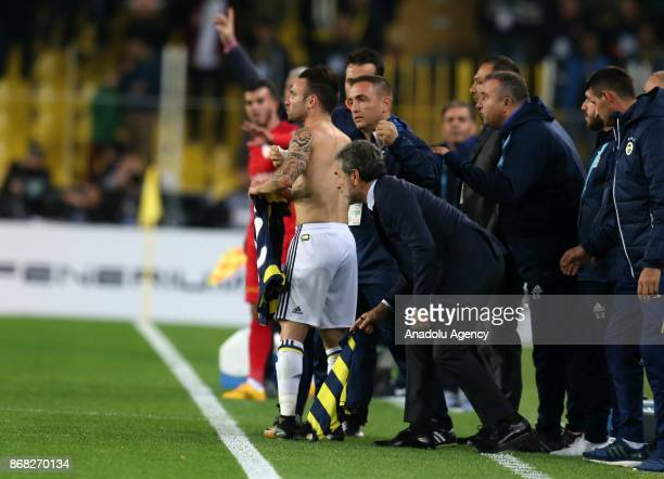 Mathieu Valbuena of Fenerbahce changes his jersey after a blood stain during a Turkish Super Lig match between Fenerbahce and Kayserispor at Ulker...