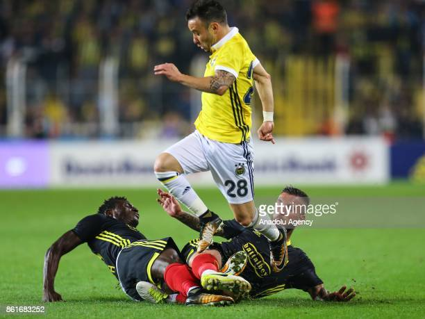 Mathieu Valbuena of Fenerbahce in action against Adem Buyuk and Muenfuh Seth Sincere of Evkur Yeni Malatyaspor during the Turkish Super Lig match...