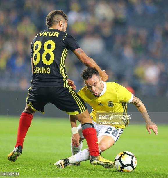 Mathieu Valbuena of Fenerbahce in action against Fernonda Dening of Evkur Yeni Malatyaspor during the Turkish Super Lig match between Fenerbahce and...