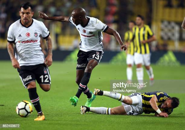 Mathieu Valbuena of Fenerbahce in action against Gary Alexis Medel and Atiba of Besiktas during the Turkish Super Lig week 6 soccer match between...