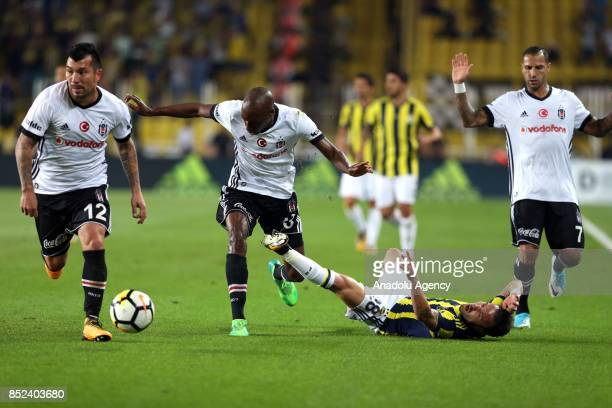 Mathieu Valbuena of Fenerbahce in action against Gary Alexis Medel Quaresma and Atiba of Besiktas during the Turkish Super Lig week 6 soccer match...
