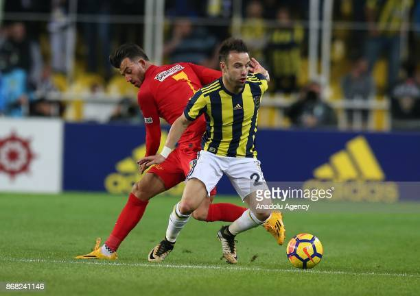 Mathieu Valbuena of Fenerbahce in action against Guray Vural during a Turkish Super Lig match between Fenerbahce and Kayserispor at Ulker Stadium in...