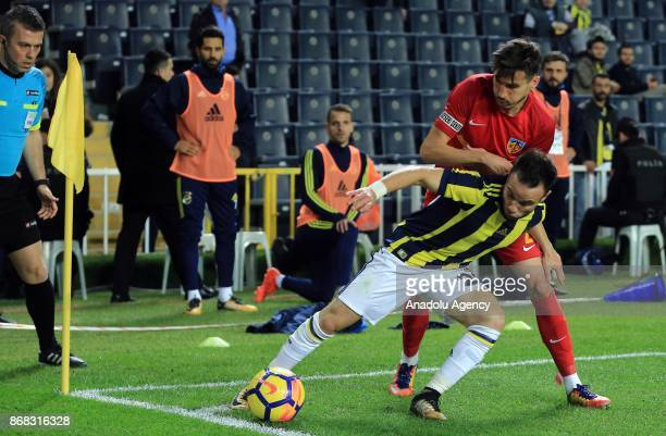 Mathieu Valbuena of Fenerbahce in action against Tiago Lopes of Kayserispor during a Turkish Super Lig match between Fenerbahce and Kayserispor at...
