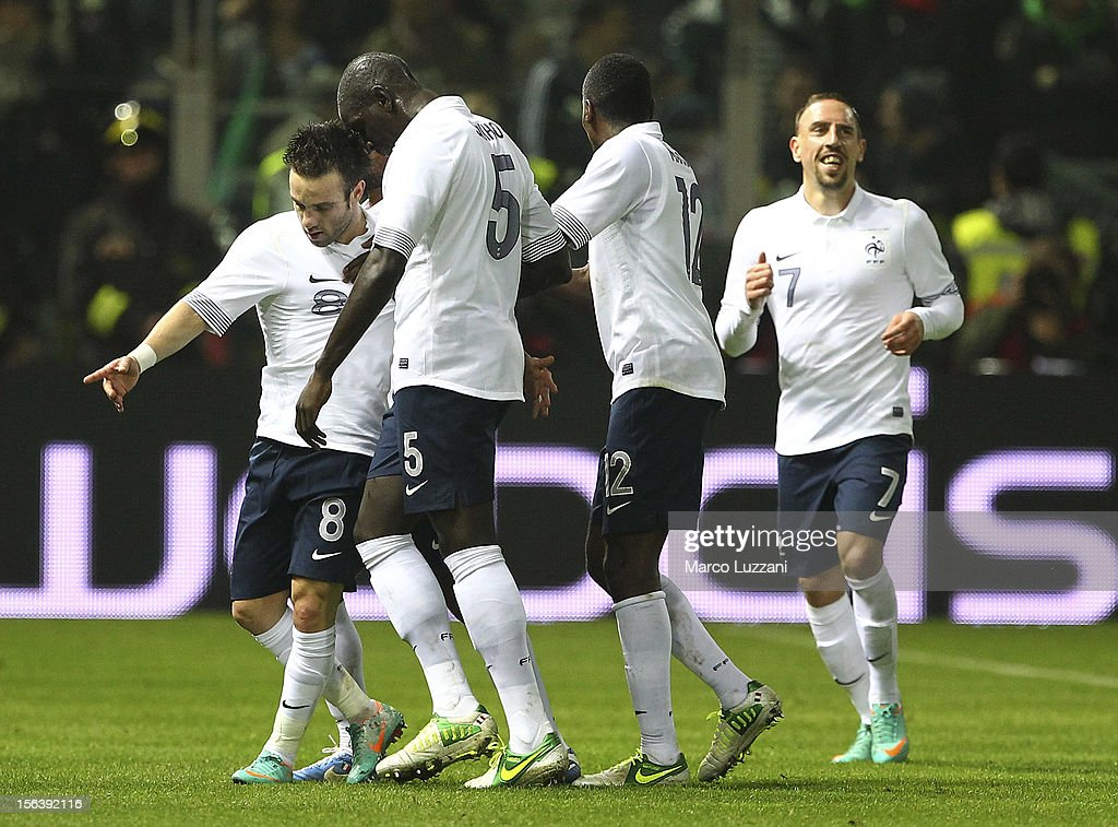 Mathieu Valbuena (L) of France celebrates with his team-mates after scoring their first goal during the international friendly match between Italy and France at Stadio Ennio Tardini on November 14, 2012 in Parma, Italy.