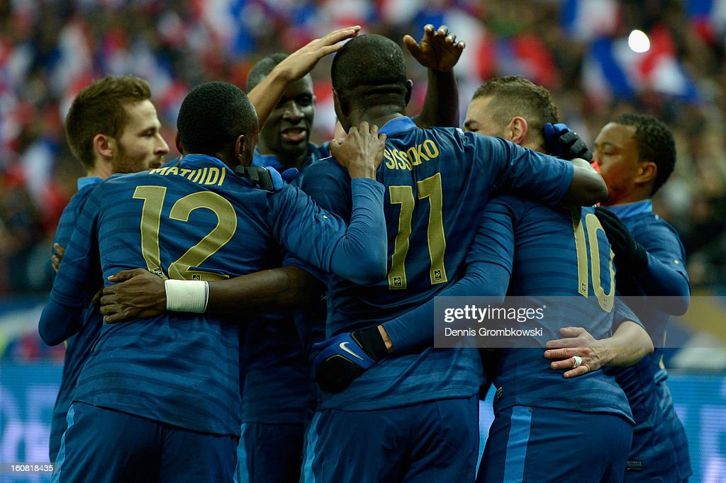 Mathieu Valbuena of France celebrates with teammates after scoring first goal during the international friendly match between France and Germany at Stade de France on February 6, 2013 in Paris, France.
