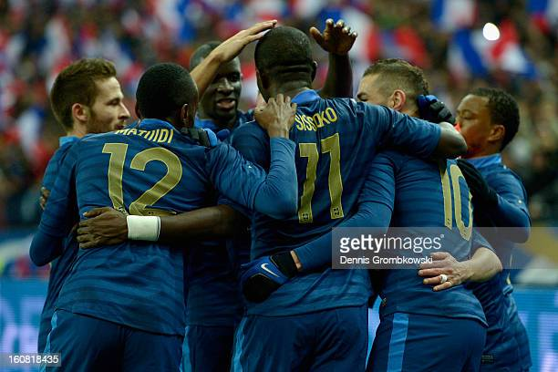Mathieu Valbuena of France celebrates with teammates after scoring first goal during the international friendly match between France and Germany at...