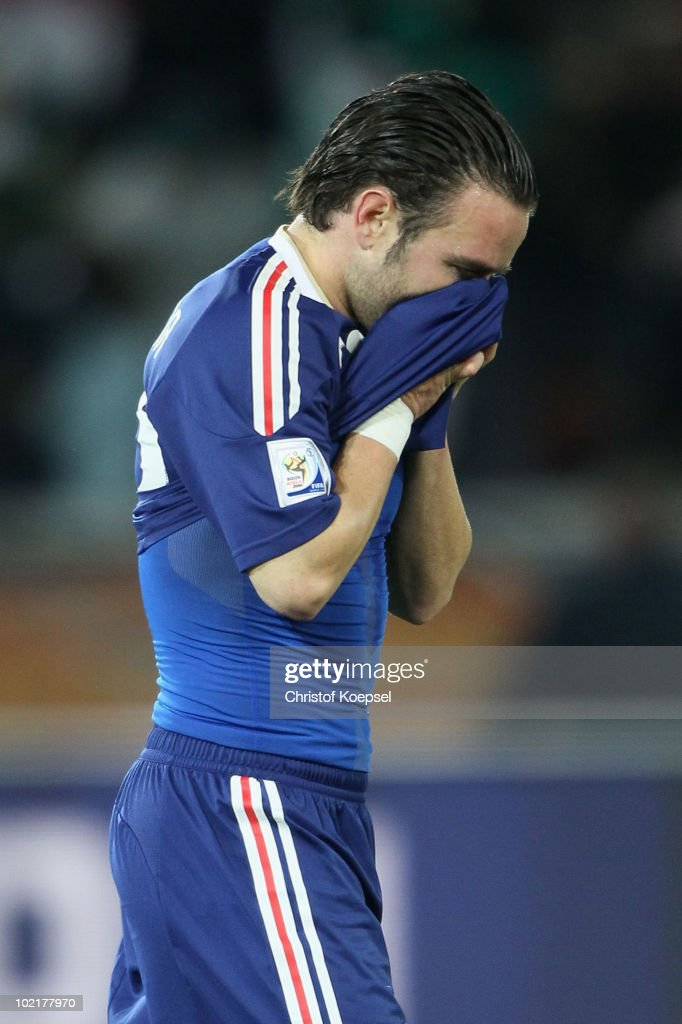 Mathieu Valbuena of France covers his face after defeat in the 2010 FIFA World Cup South Africa Group A match between France and Mexico at the Peter Mokaba Stadium on June 17, 2010 in Polokwane, South Africa.