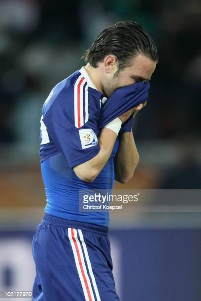 Mathieu Valbuena of France covers his face after defeat in the 2010 FIFA World Cup South Africa Group A match between France and Mexico at the Peter...