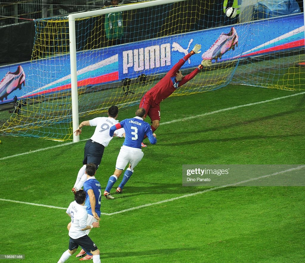 Mathieu Valbuena (L) of France scores their first goal during the international friendly match between Italy and France at Stadio Ennio Tardini on November 14, 2012 in Parma, Italy.