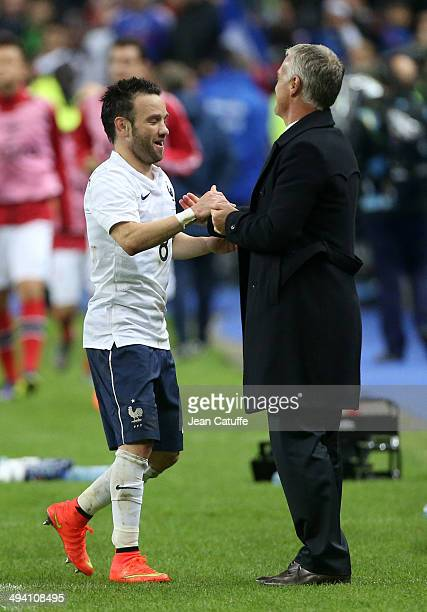 Mathieu Valbuena of France shakes hands with Didier Deschamps coach of France during the international friendly match between France and Norway at...
