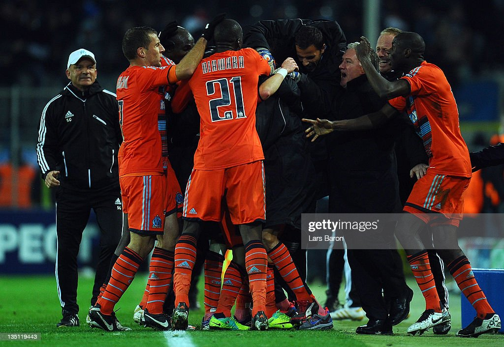 Mathieu Valbuena of Marseille celebrates with head coach Didier Deschamps and team mates after scoring the winning goal during the UEFA Champions League group F match between Borussia Dormtund and Olympique de Marseille at Signal Iduna Park on December 6, 2011 in Dortmund, Germany.