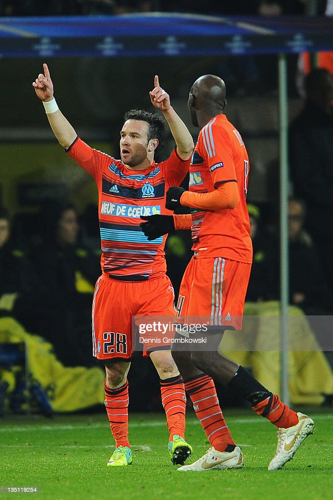 Mathieu Valbuena (L) of Marseille celebrates with team mates after scoring his team's third goal during the UEFA Champions League group F match between Borussia Dortmund and Olympique de Marseille at Signal Iduna Park on December 6, 2011 in Dortmund, Germany.