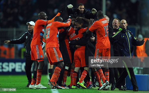 Mathieu Valbuena of Marseille celebrates with team mates after scoring the winning goal during the UEFA Champions League group F match between...