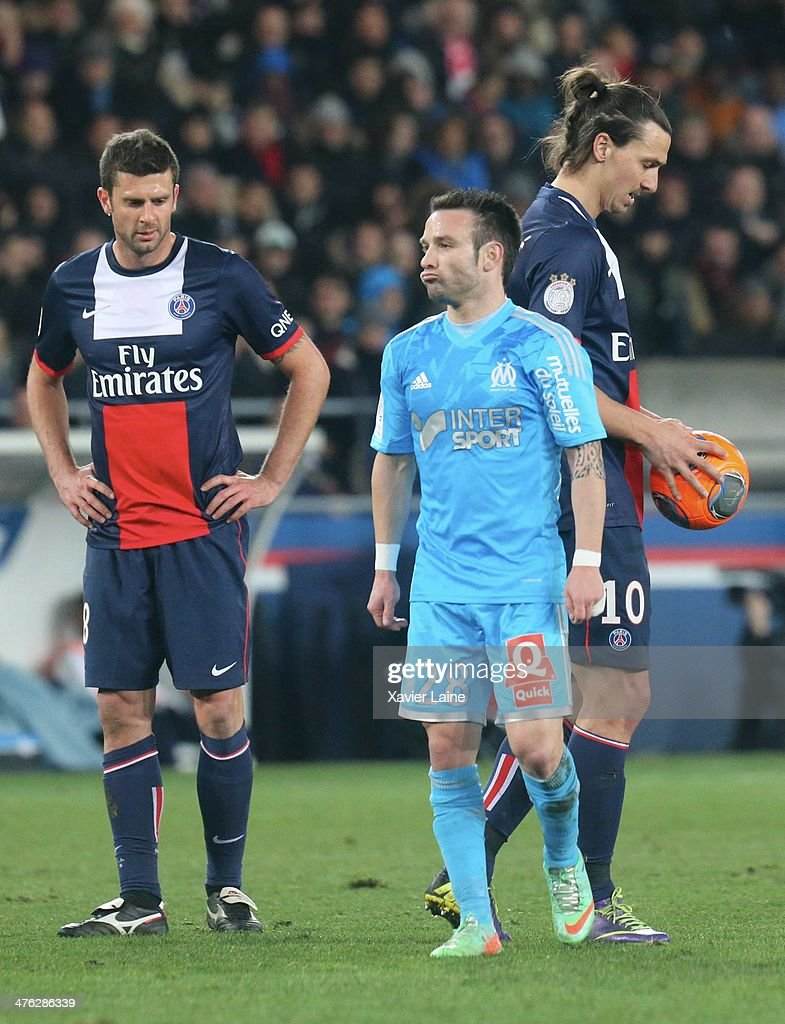 <a gi-track='captionPersonalityLinkClicked' href=/galleries/search?phrase=Mathieu+Valbuena&family=editorial&specificpeople=778610 ng-click='$event.stopPropagation()'>Mathieu Valbuena</a> of Olympique de Marseille react with <a gi-track='captionPersonalityLinkClicked' href=/galleries/search?phrase=Thiago+Motta+-+Brazilian+Soccer+Player+-+Born+1982&family=editorial&specificpeople=631059 ng-click='$event.stopPropagation()'>Thiago Motta</a> and <a gi-track='captionPersonalityLinkClicked' href=/galleries/search?phrase=Zlatan+Ibrahimovic&family=editorial&specificpeople=206139 ng-click='$event.stopPropagation()'>Zlatan Ibrahimovic</a> of Paris Saint-Germain during the French Ligue 1 between Paris Saint-Germain FC and Olympique de Marseille at Parc Des Princes on March 2, 2014 in Paris, France.