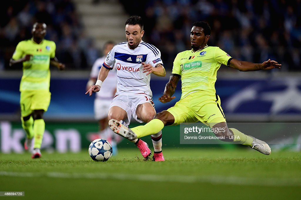 Mathieu Valbuena of Olympique Lyonnais is challenged by Renato Neto of KAA Gent during the UEFA Champions League Group H match between KAA Gent and...