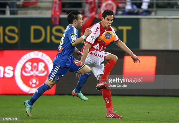 Mathieu Valbuena of OM and Aissa Mandi of Stade de Reims in action during the french Ligue 1 match between Stade de Reims and Olympique de Marseille...