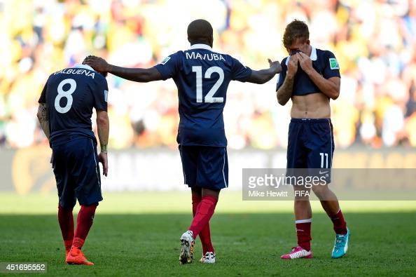 Mathieu Valbuena Rio Mavuba and Antoine Griezmann of France react after the 01 defeat in the 2014 FIFA World Cup Brazil Quarter Final match between...