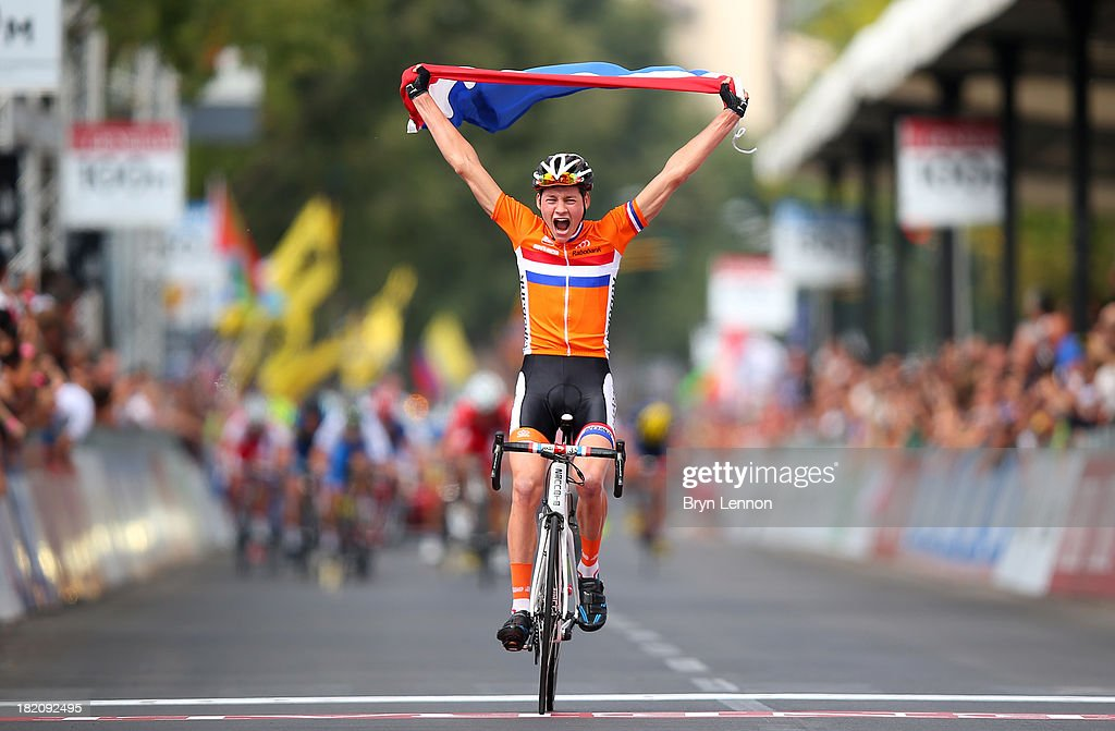 Mathieu van der Poel of the Netherlands celebrates crossing the finish line and winning the Junior Men's Road Race on September 28, 2013 in Florence, Italy.
