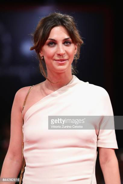 Mathilde Auneveux walks the red carpet ahead of the 'Jusqu'a La Garde' screening during the 74th Venice Film Festival at Sala Grande on September 8...
