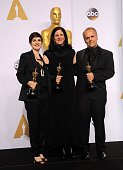 Mathilde Bonnefoy director Laura Poitras and Dirk Wilutzky winners of est Documentary Feature Award for 'Citizenfour' pose inside the press room of...