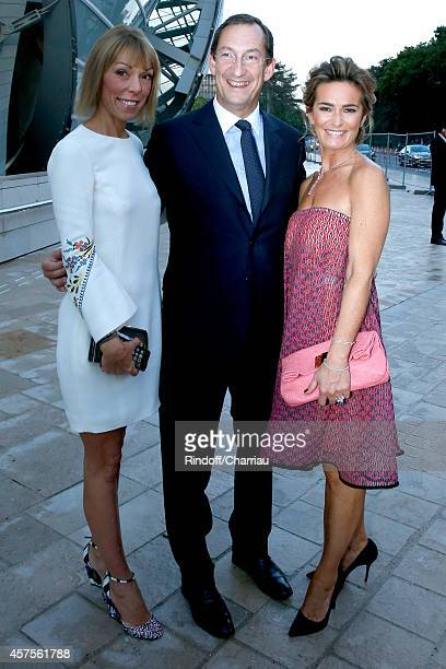 Mathilde Favier Nicolas Bazire and his wife Fabienne attend the Foundation Louis Vuitton Opening at Foundation Louis Vuitton on October 20 2014 in...