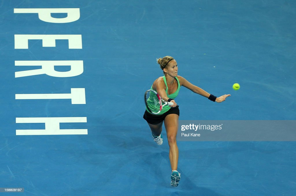 Mathilde Johansson of France plays a forehand in her singles match against Anabel Medina Garrigues of Spain during day two of the Hopman Cup at Perth Arena on December 30, 2012 in Perth, Australia.