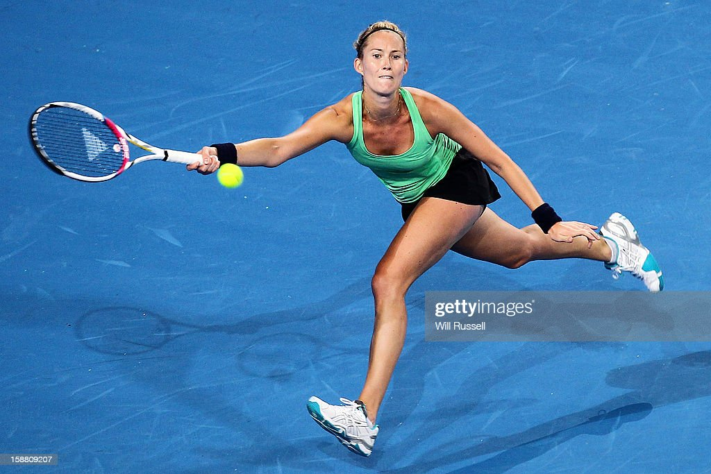 <a gi-track='captionPersonalityLinkClicked' href=/galleries/search?phrase=Mathilde+Johansson&family=editorial&specificpeople=599541 ng-click='$event.stopPropagation()'>Mathilde Johansson</a> of France plays a forehand in her singles match against Anabel Medina Garrigues of Spain during day two of the Hopman Cup at Perth Arena during day two of the Hopman Cup at Perth Arena on December 30, 2012 in Perth, Australia.