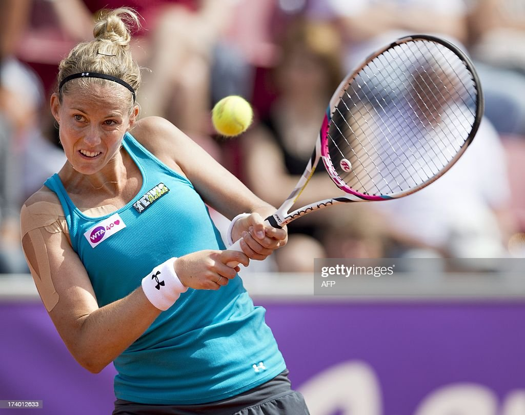 Mathilde Johansson of France returns the ball to Swedish player Johanna Larsson during one of the two quarter finals in women's single match at the Swedish Open tennis tournament in Bastad, Sweden, on July 19, 2013. AFP PHOTO/Scanpix Sweden/Bjorn Larsson Rosvall / SWEDEN OUT
