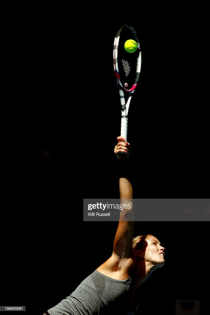 Mathilde Johansson of France serves in her singles match against Chanelle Scheepers of South Africa during day seven of the Hopman Cup at Perth Arena on January 4, 2013 in Perth, Australia.