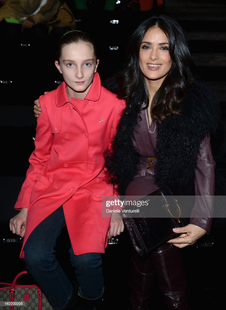 Mathilde Pinault and <a gi-track='captionPersonalityLinkClicked' href=/galleries/search?phrase=Salma+Hayek&family=editorial&specificpeople=201844 ng-click='$event.stopPropagation()'>Salma Hayek</a> attend the Gucci fashion show as part of Milan Fashion Week Womenswear Fall/Winter 2013/14 on February 20, 2013 in Milan, Italy.