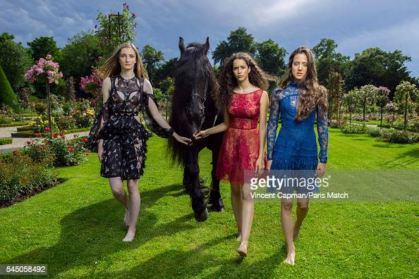 Mathilde Pinault Iman Perez and Flore Giraud are photographed for Paris Match with a horse called Le Frison in the Bagatelle gardens on June 22 2016...