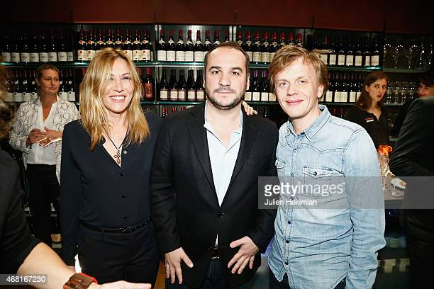 Mathilde Seigner Francois Xavier Demaison and Alex Lutz attend 'L'Atelier Maitre Albert' Cocktail In Paris on March 30 2015 in Paris France