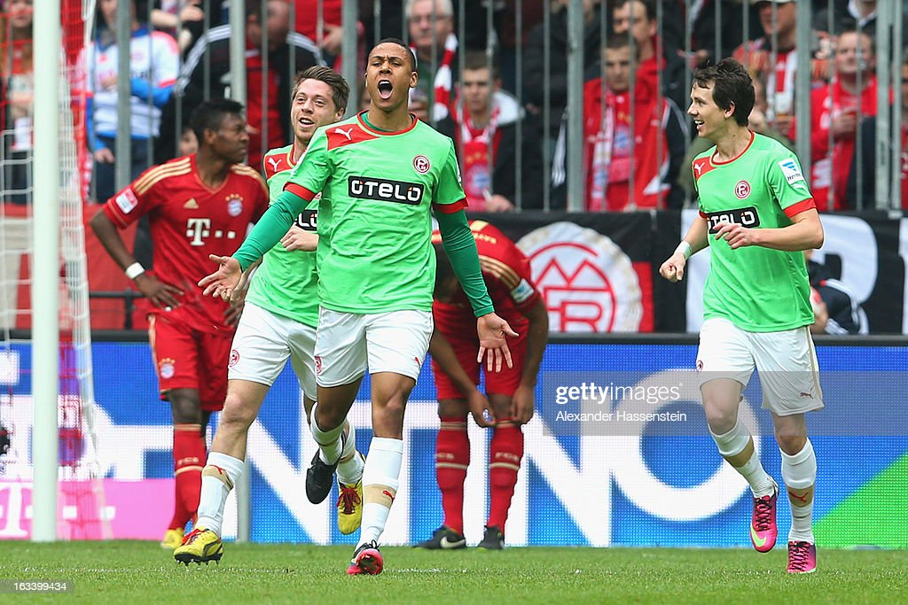 Mathis Bolly (3rd L) of Duesseldorf celebrates scoring the opening goal during the Bundesliga match between FC Bayern Muenchen and Fortuna Duesseldorf 1895 at Allianz Arena on March 9, 2013 in Munich, Germany.