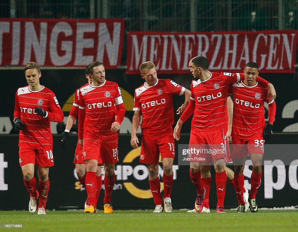 Mathis Bolly (R) of Duesseldorf celebrates with his team mates after scoring his team's first goal during the Bundesliga match between VfL Wolfsburg and Fortuna Duesseldorf 1895 at Volkswagen Arena on March 15, 2013 in Wolfsburg, Germany.