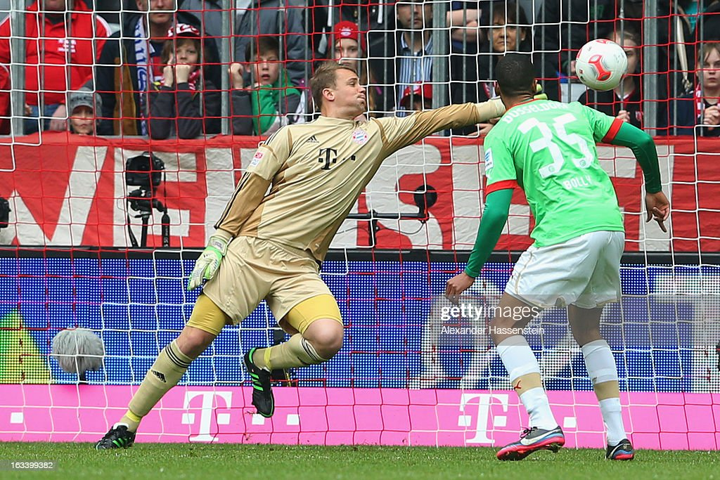 Mathis Bolly (R) of Duesseldorf scores the opening goal against <a gi-track='captionPersonalityLinkClicked' href=/galleries/search?phrase=Manuel+Neuer&family=editorial&specificpeople=764621 ng-click='$event.stopPropagation()'>Manuel Neuer</a>, keeper of Muenchen during the Bundesliga match between FC Bayern Muenchen and Fortuna Duesseldorf 1895 at Allianz Arena on March 9, 2013 in Munich, Germany.
