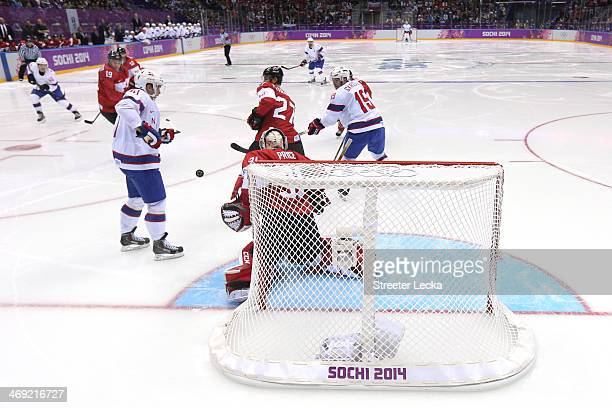 Mathis Olimb of Norway scores a goal on Carey Price of Canada in the third period during the Men's Ice Hockey Preliminary Round Group B game on day...