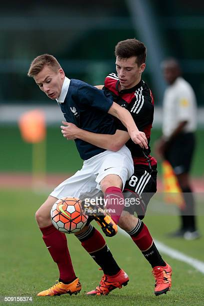 Mathys Picouleau of France challenges Adrian Stanilewicz of Germany during the UEFA Under16 match between U16 France v U16 Germany on February 6 2016...