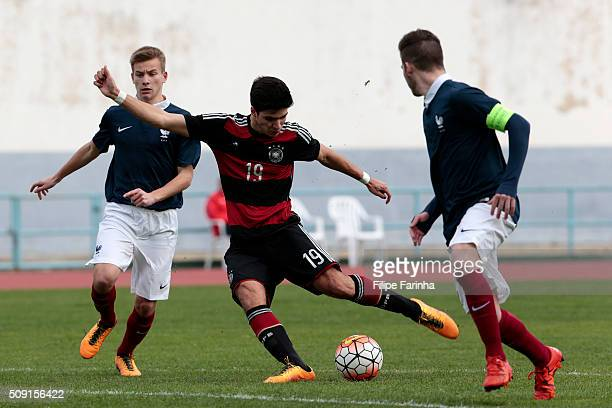 Mathys Picouleau of France challenges Elias Abouchabaka of Germany during the UEFA Under16 match between U16 France v U16 Germany on February 6 2016...